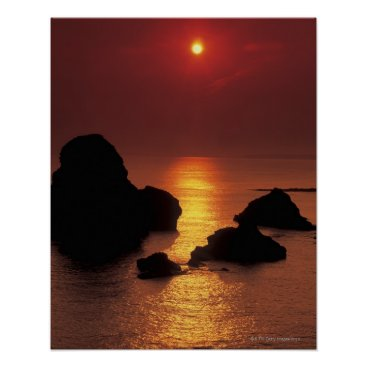 Beach Themed view of the sun setting over the sea poster