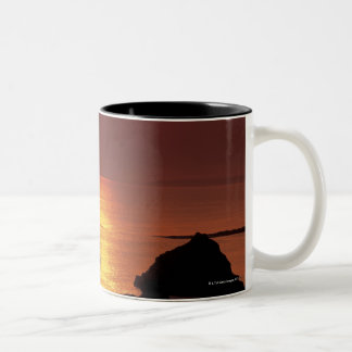 view of the sun setting over the sea Two-Tone coffee mug