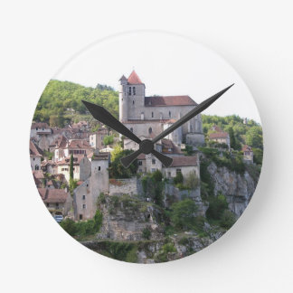 View of the village and the church (photo) 3 round clock