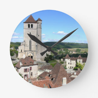 View of the village and the church (photo) round clock