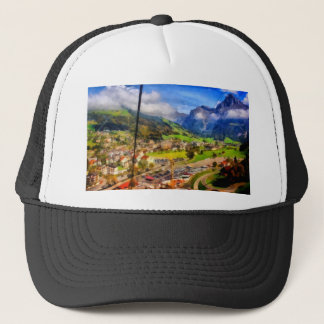 View of town below a cable car in Switzerland Trucker Hat
