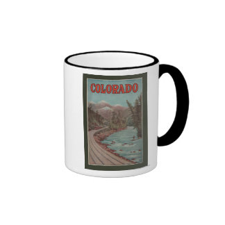 View of Train Alongside River - Travel Poster Coffee Mugs