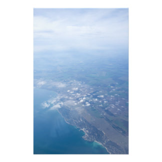 View on the seacoast through the airplane window flyer