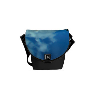 View over the ocean to the rocks with waterfall messenger bag
