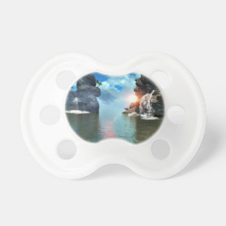 View over the ocean to the rocks with waterfall BooginHead pacifier