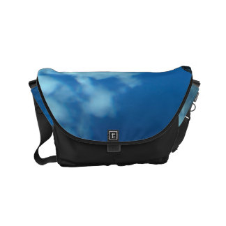 View over the ocean to the rocks with waterfall small messenger bag