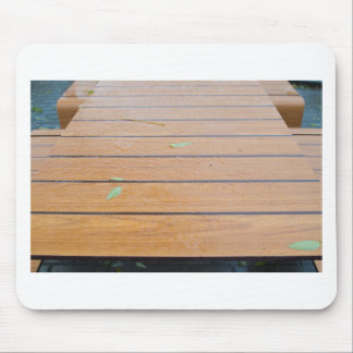 View tables wet after the rain in a cafe closeup mouse pad
