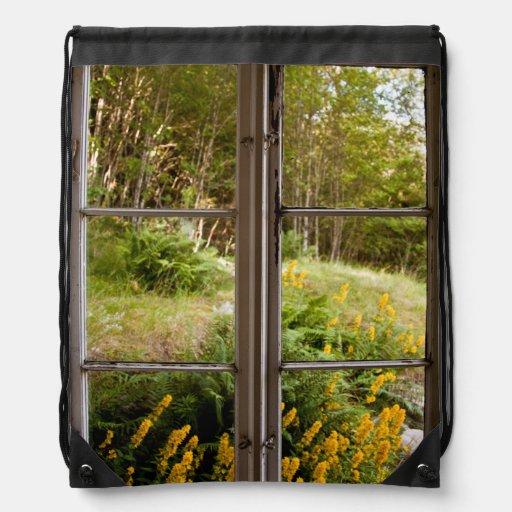 View through old window drawstring backpacks