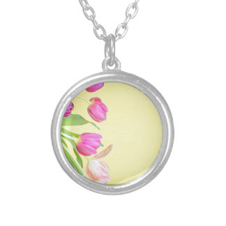 View to the multicolored tulips over yellow paper silver plated necklace