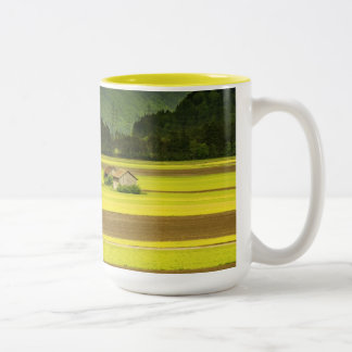 Views of orchards and fields under mountains Two-Tone coffee mug
