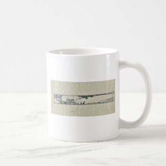 Vignette of a man fishing from the bank of a river coffee mugs