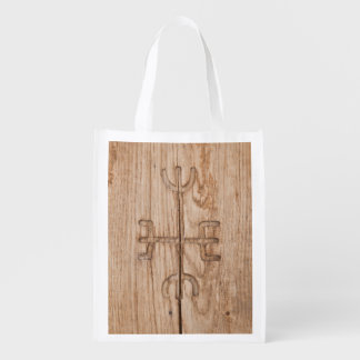 Viking rune on cracked wood grocery bags