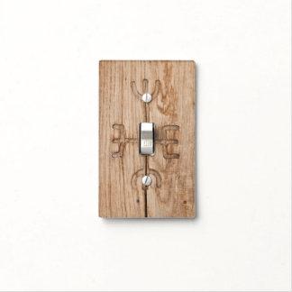 Viking rune on cracked wood light switch cover