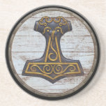 "Viking Shield - Mjolnir Drink Coaster<br><div class=""desc"">A quality sandstone coaster featuring the classic Thor&#39;s Hammer design over beautifully weathered wooden Viking shield background.</div>"