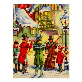 Villancicos del navidad del canto en una tarde Nev Postal