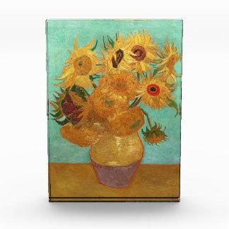 Vincent van Gogh doce girasoles en un florero