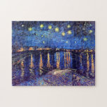 """Vincent Van Gogh - Starry Night Over The Rhone Jigsaw Puzzle<br><div class=""""desc"""">This oil on canvas from 1888 is a painting Van Gogh did at night on the banks of the Rhone river, only a few blocks from the famous &#39;yellow house&#39; he was renting at the time. Unlike similar stores, Art Lover&#39;s Cafe features classic, high resolution works of art that have...</div>"""