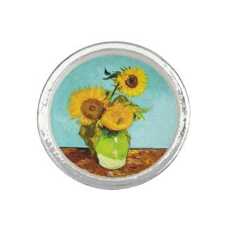 Vincent van Gogh tres girasoles en un florero