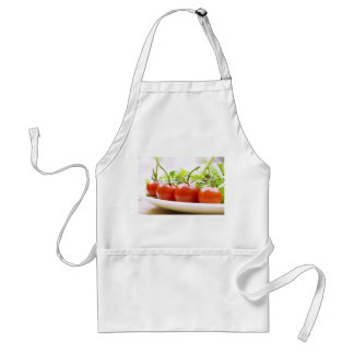 Vine tomatoes on a salad plate close up adult apron