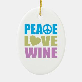 Vino del amor de la paz adorno navideño ovalado de cerámica