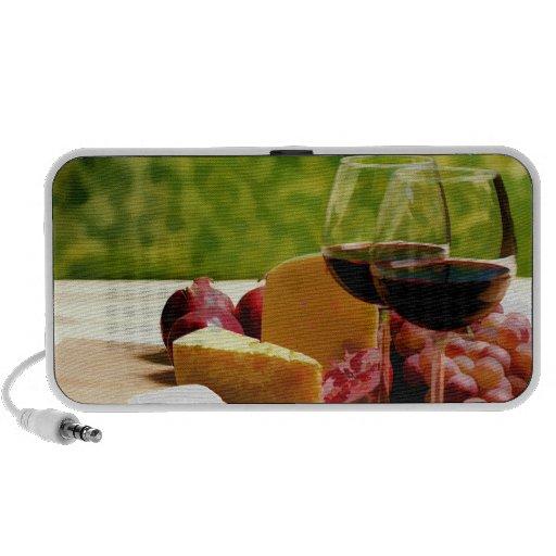 Vino, queso y fruta del campo laptop altavoz