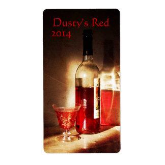 Vino rojo en etiqueta del vino de la luz de la etiqueta de envío