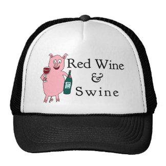 Vino rojo y cerdos gorras