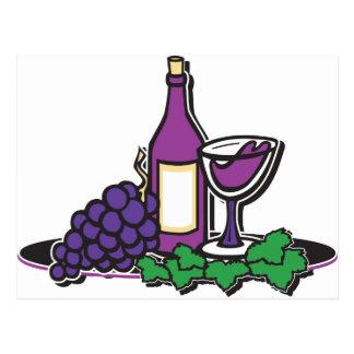 Vino rojo y uvas púrpuras postal