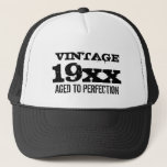 "Vintage Aged to perfection Birthday hat for men<br><div class=""desc"">Vintage Aged to perfection Birthday hat for men. Funny quote with custom year of birth. Cool typography. Age humor for 30th 40th 50th 60th 70th 80th 90th Birthday party. Cute personalized gift idea for over the hill dad,  father,  uncle,  brother,  husband,  grandpa,  stepdad etc.</div>"