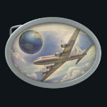 "Vintage Airplane Flying Around the World in Clouds Oval Belt Buckle<br><div class=""desc"">Vintage illustration travel and transportation design featuring a Douglas DC-7,  four-engined,  commercial,  propeller aircraft. flying around the world. Fluffy white clouds in the sky high above the earth.</div>"