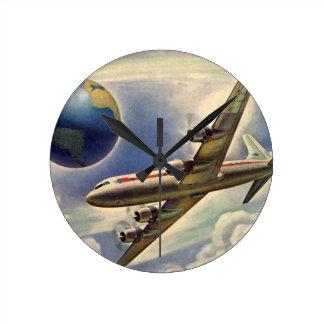 Vintage Airplane Flying Around the World in Clouds Round Clock
