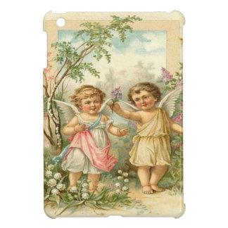 Vintage, ángeles lindos que caminan en el jardín