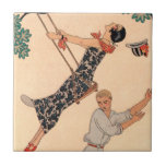 "Vintage Art Deco Love, The Swing by George Barbier Tile<br><div class=""desc"">Vintage illustration love and romance art deco image with a couple flirting, playing and carefree in the park during the spring season. The woman is swinging on a swing from a tree, her hat is falling off and she is wearing a beautiful floral dress with blooming flowers. The man is...</div>"