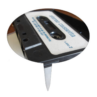 Vintage audio cassette tape on wooden table cake topper