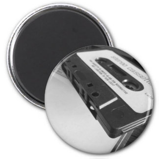 Vintage audio cassette tape on wooden table magnet