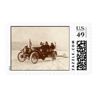 Vintage automobile in the snow postage