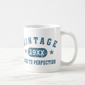 Vintage azul del texto envejecido a la taza de la