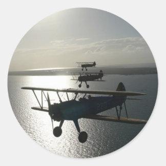 Vintage bi-planes in formation classic round sticker