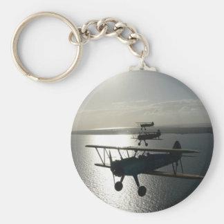 Vintage bi-planes in formation keychain
