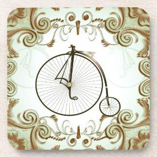 Vintage, bicicleta con los elementos florales posavasos de bebidas