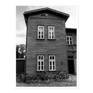Vintage bikes by the wooden house black/white postcard