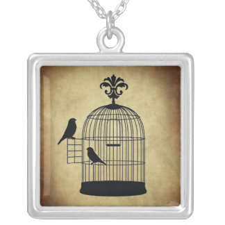 vintage birdcage stamp. silver plated necklace