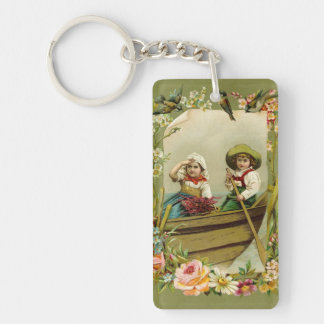 Vintage boy and girl rowing on a boat - retro keychain