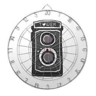 Vintage camera black and gray dartboard with darts