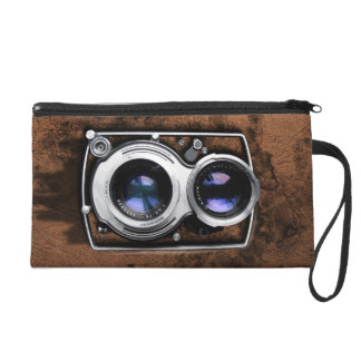 Vintage camera on brown leather grunge wall