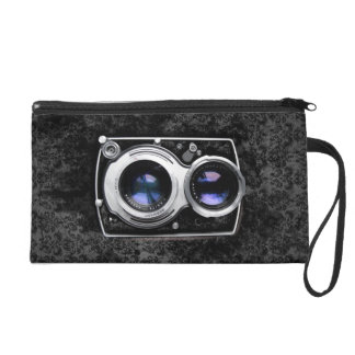 Vintage camera on damask leather grunge wall