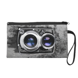 Vintage camera on grey leather grunge wall