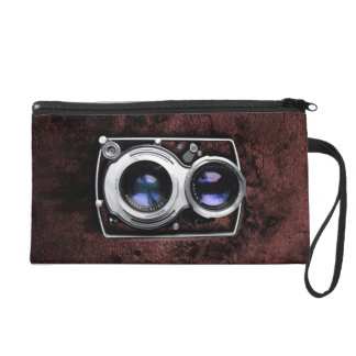Vintage camera on red leather grunge wall