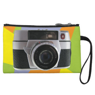 Vintage camera with a bright geometric background wristlet purses