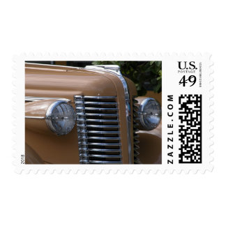 Vintage car with Hood Ornament showing Postage